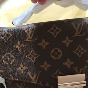 Brand new Luis Vuitton made in France hand purse